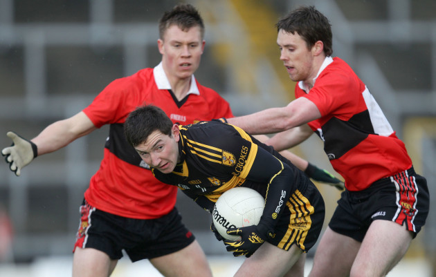 Daithi Casey under pressure from Niall Daly and Sean Kiely