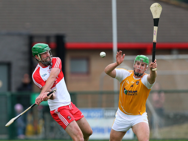 Matthew Donnelly tries to block down Ruairi Convery