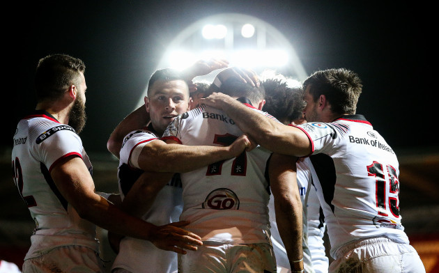 Jacob Stockdale celebrates scoring a try with teammates