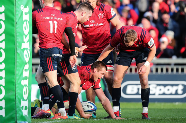 CJ Stander celebrates scoring his sides second try with JJ Hanrahan and Mike Haley