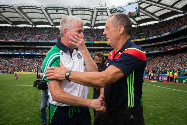 John Meyler shakes hands with John Kiely after the game
