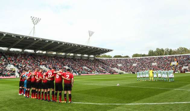 The teams observe a minute's silence