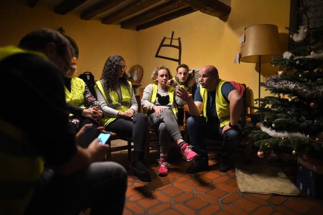 Yellow Vests Watching Emmanuel Macron Speech