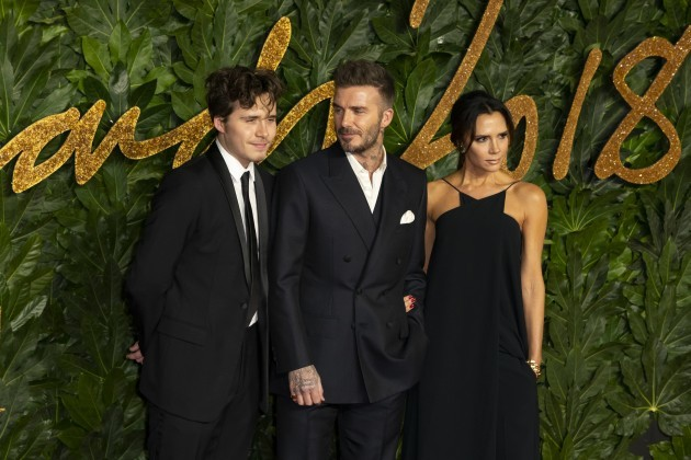 Brooklyn Beckham, David Beckham and Victoria Beckham attend The Fashion Awards 2018 at The Royal Albert Hall. London, UK. 10/12/2018