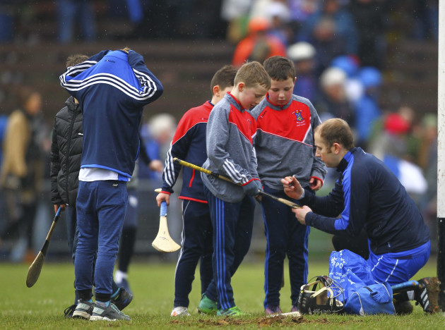 Waterford's Ian O'Regan stops to sign autographs for fans at the end of the game