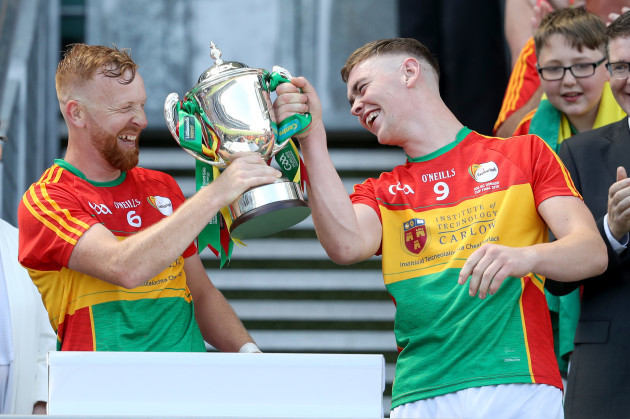 Richard Coady lifts the trophy with Diarmuid Byrne