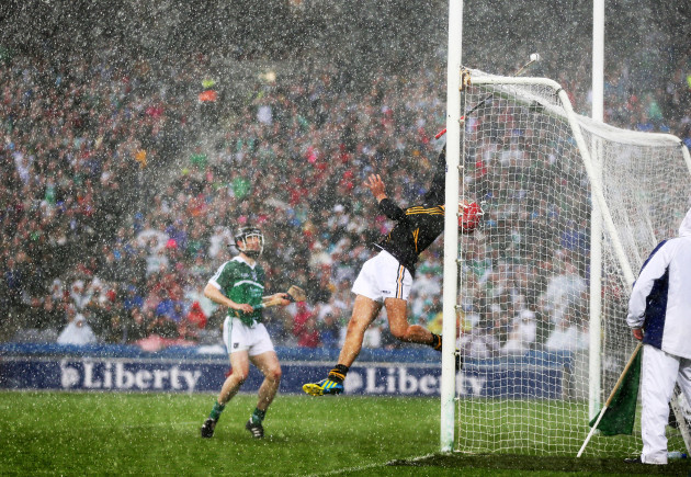 David Herity attempts to prevent the sliotar from going over the bar
