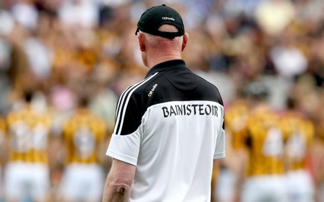 Brian Cody looks on as the Kilkenny team photo is taken