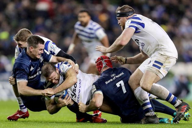 Jamie Roberts tackled by Johnny Sexton and Josh van der Flier
