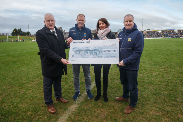 Martina Cox is presented with a cheque by John Kavanagh, Fergus McNulty and Peter O'Halloran