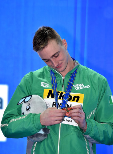 Shane Ryan celebrates with his bronze medal
