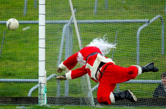 Santa Claus saves a penalty during a shoot out at half time