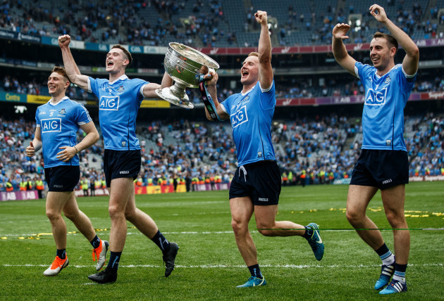 John Small, Brian Fenton, Ciaran Kilkenny and Cormac Costello celebrates after the game with the trophy