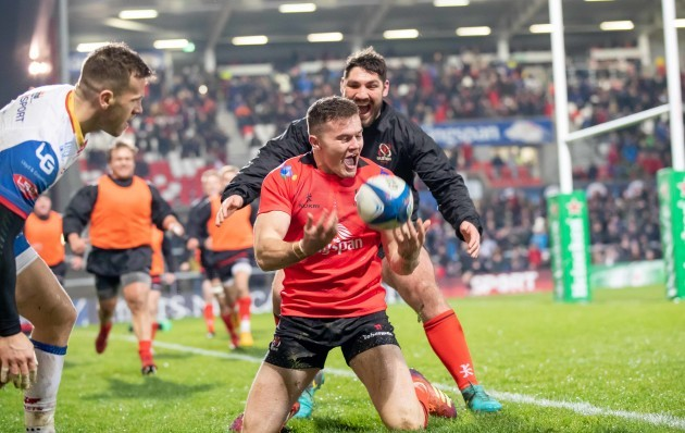 Jacob Stockdale celebrates scoring a try with Tommy O'Toole