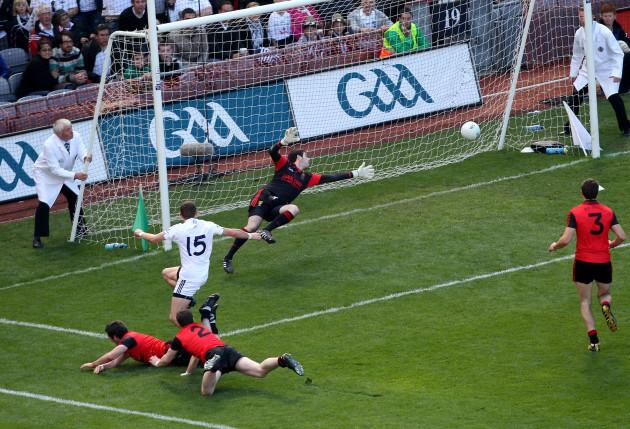 Eamonn Callaghan shoots past goalkeeper Brendan McVeigh