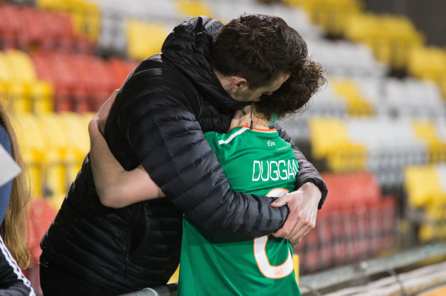 A dejected Karen Duggan is comforted at the end of the game