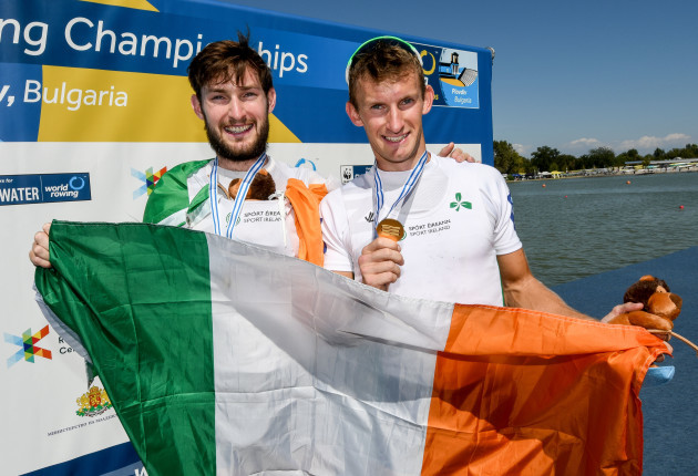 Paul and Gary O'Donovan celebrate with their gold medals