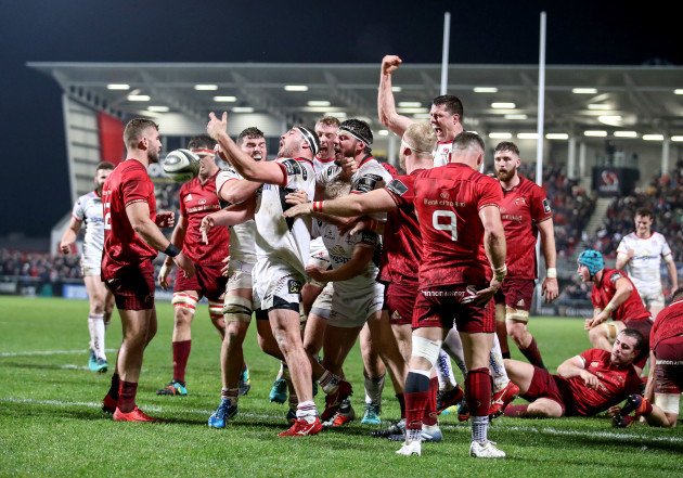Rob Herring celebrates scoring a try with teammates