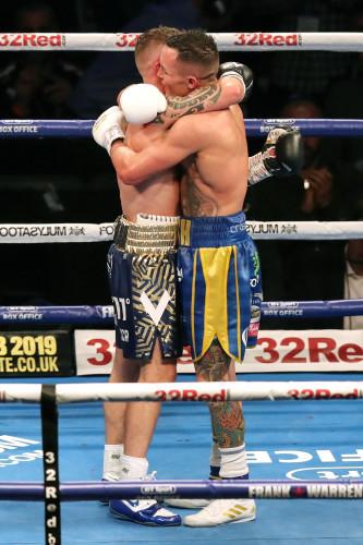 Carl Frampton and Josh Warrington embrace