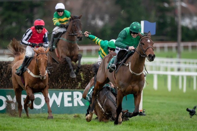 Ruby Walsh clears the last on FootPad ahead of eventual winner Mark Walsh on Simply Ned as Barry Geraghty falls from Ballyoisin