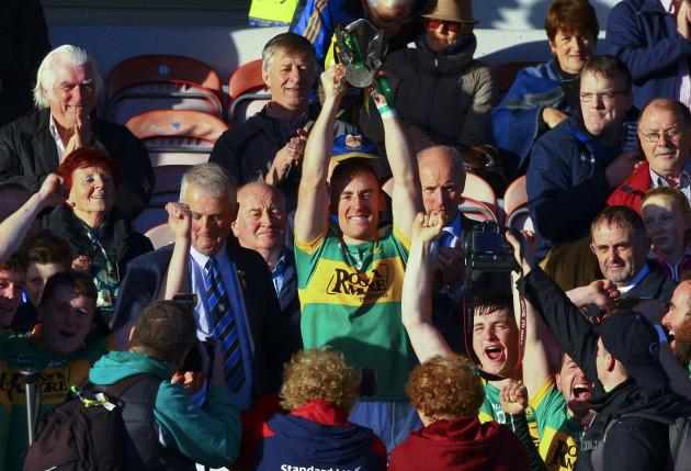 John O'Keeffe raises the cup