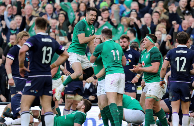 Sean Cronin celebrates scoring his sides bonus point try with Conor Murray and Jacob Stockdale