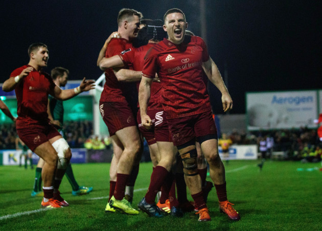 Andrew Conway celebrates after Joey Carbery scored his sides fourth try