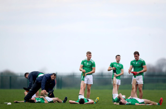 Limerick players stretch after the game