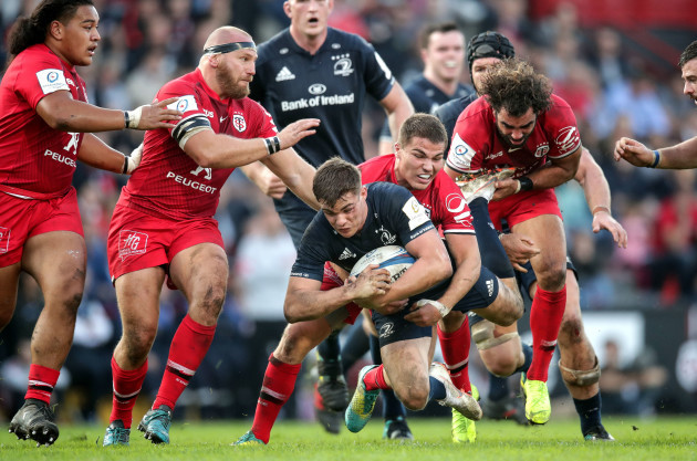Garry Ringrose tackled by Antoine Dupont and Yoann Huget