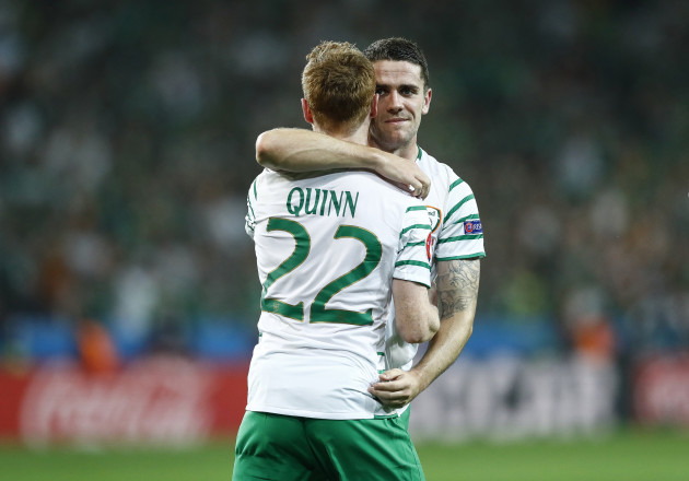Robbie Brady celebrates with Stephen Quinn