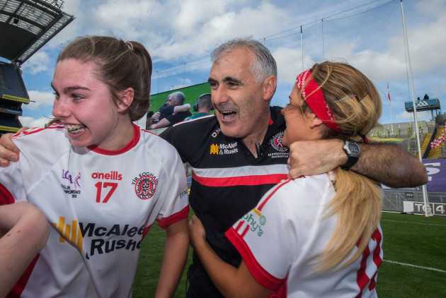 Gerry Moane celebrates with Maria Canavan and Lycrecia Quinn after the game