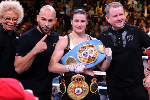 Katie Taylor celebrates her victory with her team