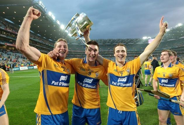 Cian Dillon, Conor Ryan and Patrick O'Connor celebrate with the Liam McCarthy