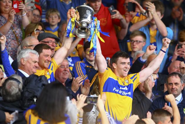 Cian Dillon and Tony Kelly lift the cup