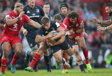 Leinsters Garry Ringrose  is tackled by Toulouse's Antoine Dupont