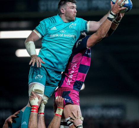 Franco Mostert competes for a line out with Peter O'Mahony