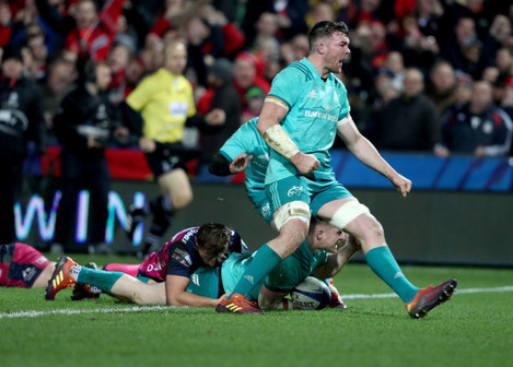 Keith Earls and Peter O'Mahony celebrate as Rory Scannell scores their second try