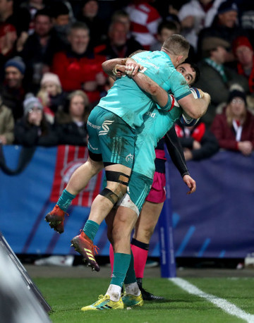 Conor Murray congratulates Andrew Conway after scoring a try