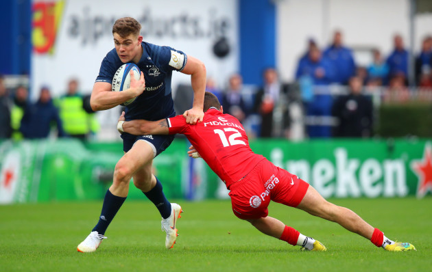 Garry Ringrose is tackled by Romain Ntamack