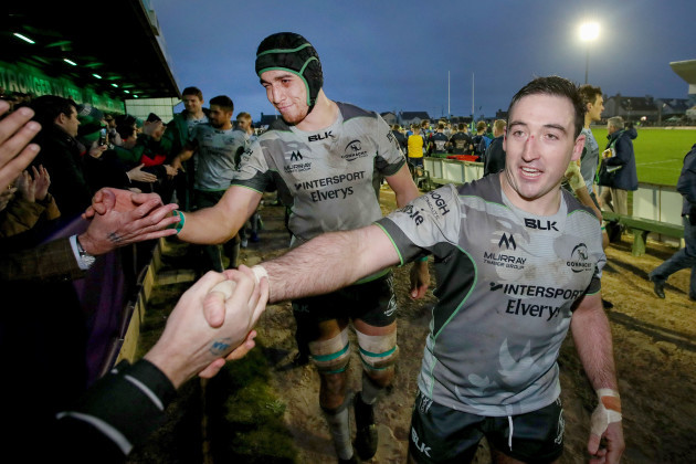 Ultan Dillane and Denis Buckley celebrate after the game with fans