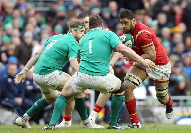 Taulupe Faletau charges at Jamie Heaslip and Jack McGrath