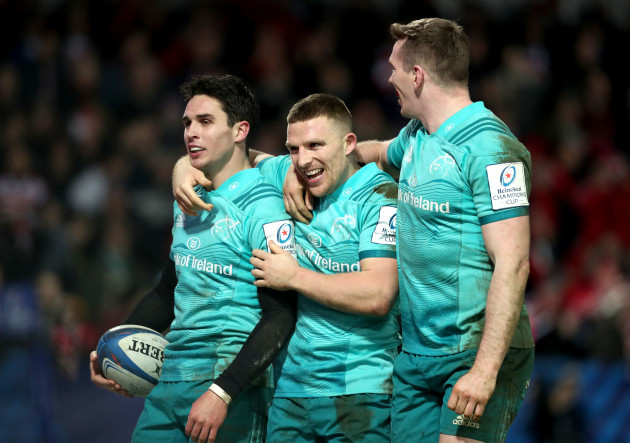 Joey Carbery celebrates scoring his second try with Andrew Conway and Chris Farrell