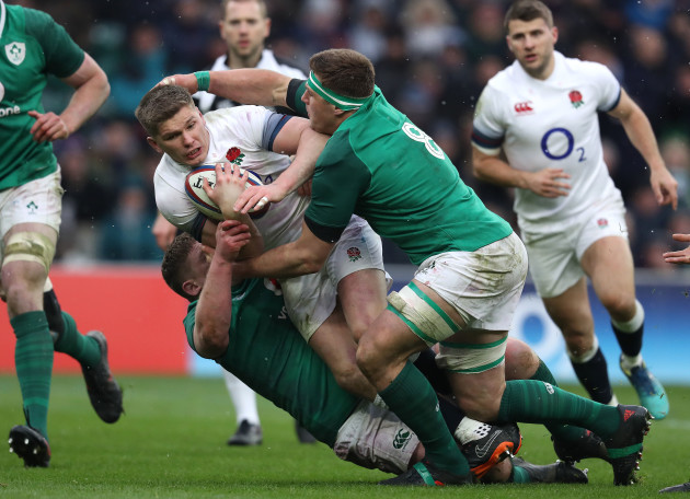 Owen Farrell is tackled by Tadhg Furlong and CJ Stander