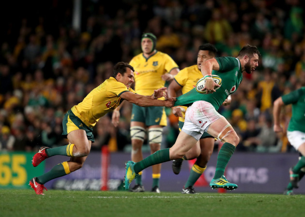 Robbie Henshaw is tacked by Nick Phipps