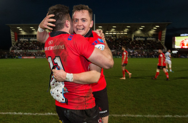 Jacob Stockdale celebrates at the final whistle with Michael Lowry