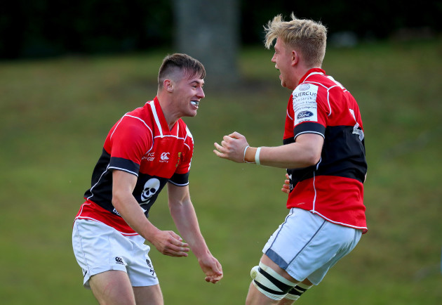 James Taylor celebrates scoring a try with Mark Bissesar