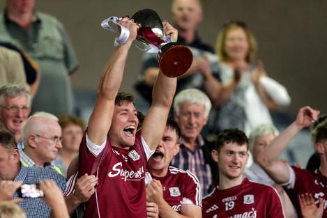 Fintan Burke lifts the trophy