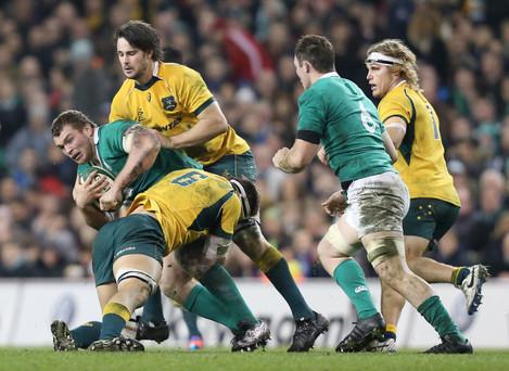 Jack McGrath is tackled by Luke Jones and Sam Carter