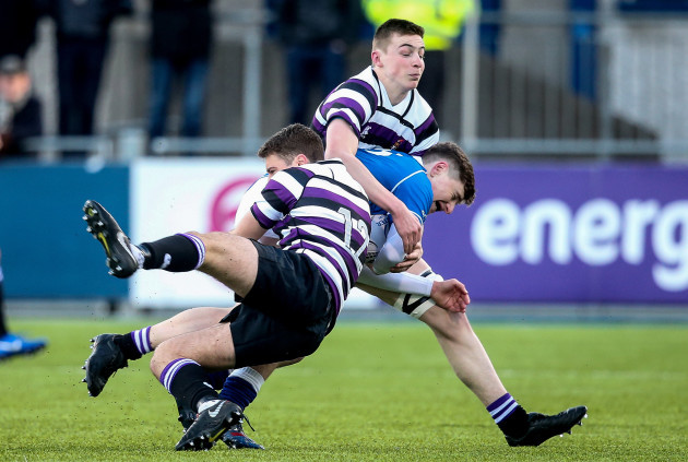 Jack McSharry is tackled by Henry Roberts and Tom Ruane