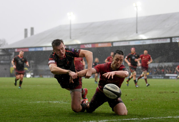 Darren Sweetnam attempts to beat Will Talbot-Davies to the ball